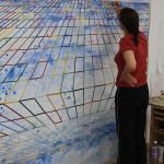 Aan het werk met het schilderij van 500×220 cm